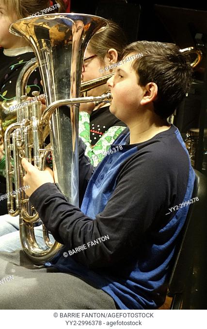 Boy With Autism Playing Tuba in Middle School Band, Wellsville, New York, USA