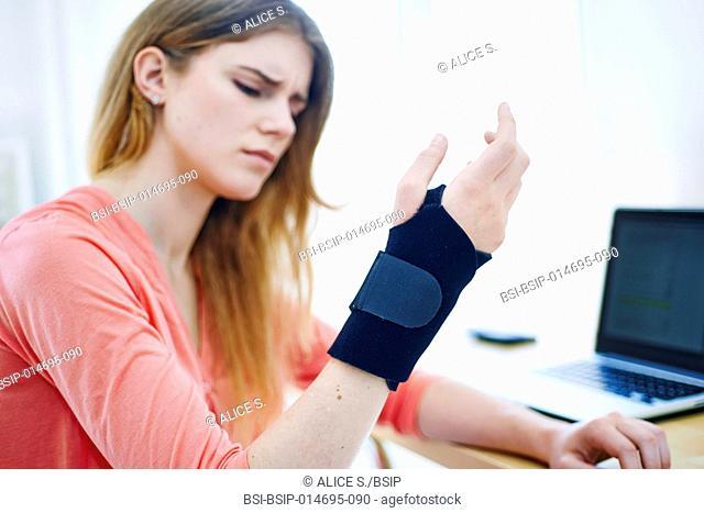 Woman wearing a wrist splint