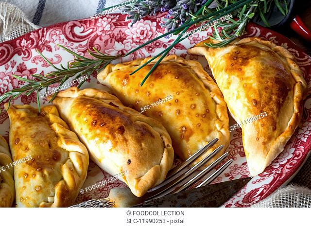 A plate of Spanish pasties filled with meat and tuna