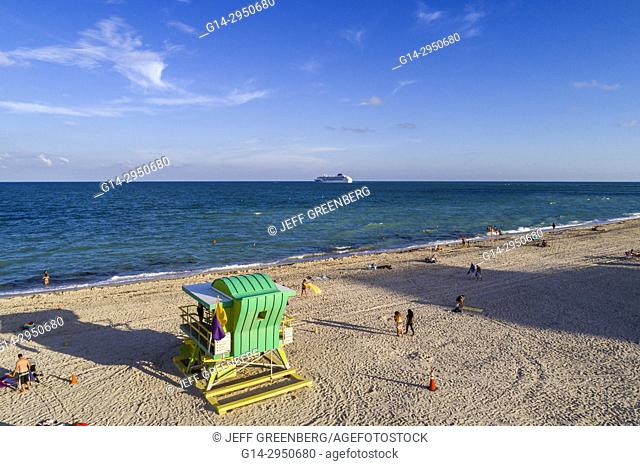 Florida, Miami Beach, water, sand, Atlantic Ocean, lifeguard station hut, departing cruise ship, aerial overhead bird's eye view above