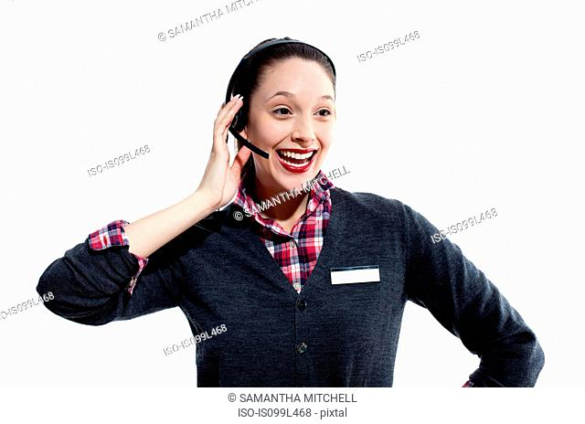 Happy young woman on telephone headset