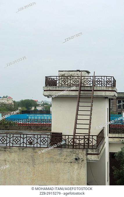 Wooden ladder on rooftop Kharian village Pakistan