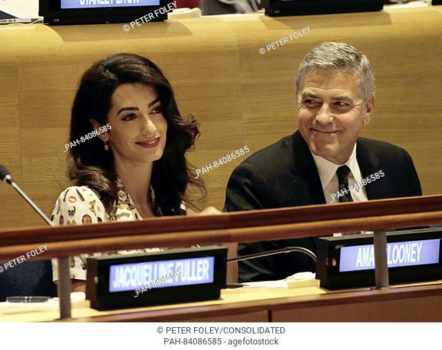United States actor George Clooney (R) and wife Amal Clooney attend a Leaders Summit for Refugees during the United Nations 71st session of the General Debate...