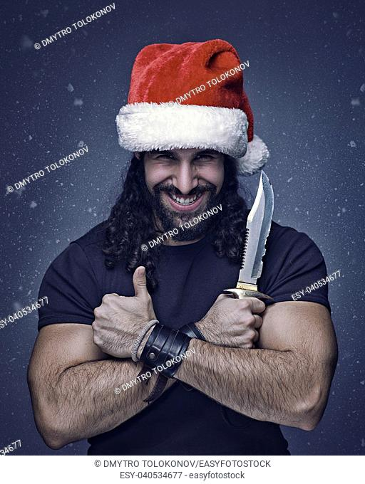 Bad Santa, funny male portrait, brutal man with knife