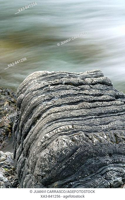 Lined rock beside river Estos valley, Posets maladeta natural park, Huesca province, Aragon, Spain