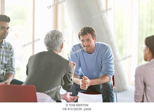 Business people talking in group meeting