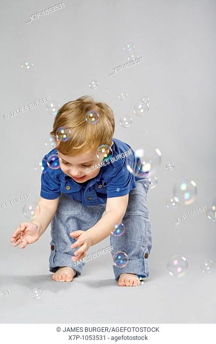 2 year old boy with bubbles