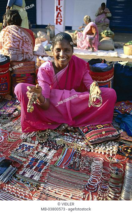 India, Goa, Anjuna, Indian,  Sale, jewelry,  Asia, South Asia, market, flea market, woman, natives, Clothing traditional, pink, laughing, cheerfully, dealer