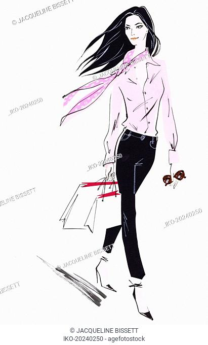 Elegant woman in jeans carrying shopping bags