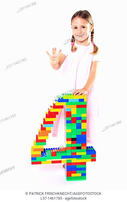 Little girl playing with Lego, Switzerland