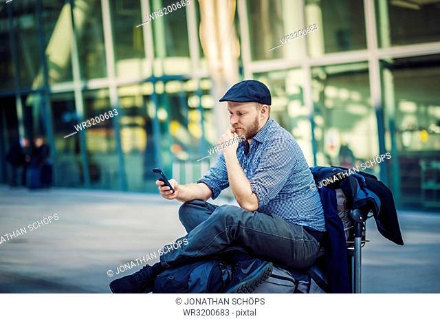 Waiting traveler on airport, London, England