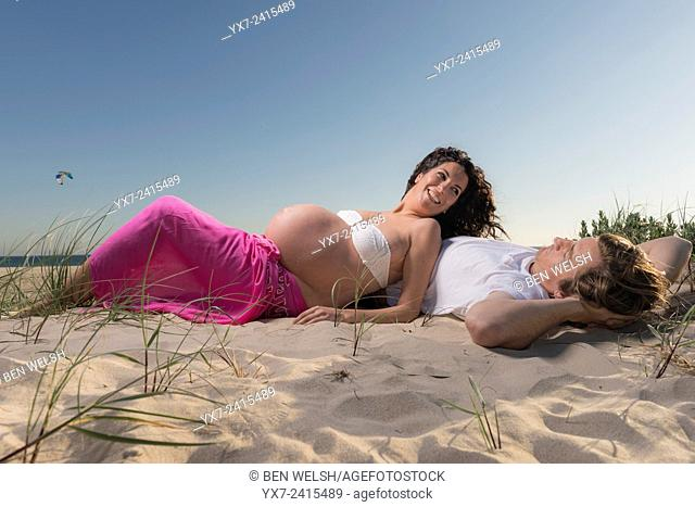 Man and pregnant woman at the beach. Tarifa, Costa de la Luz, Cadiz, Andalusia, Spain, Europe