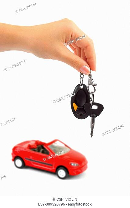 Hand with key and car