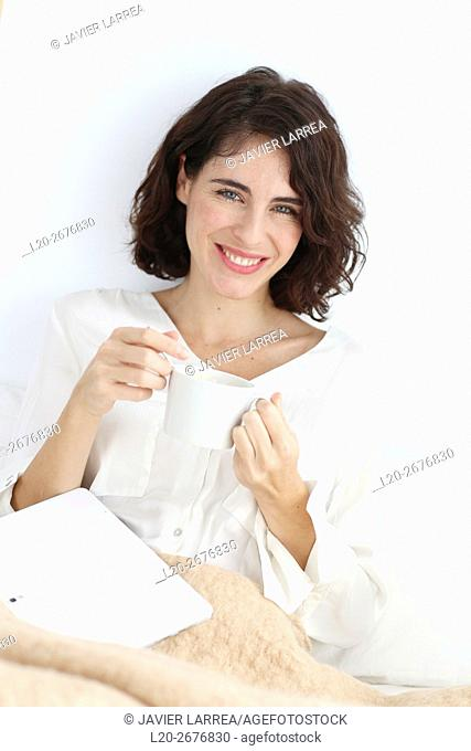 Portrait of Woman holding cup of coffee