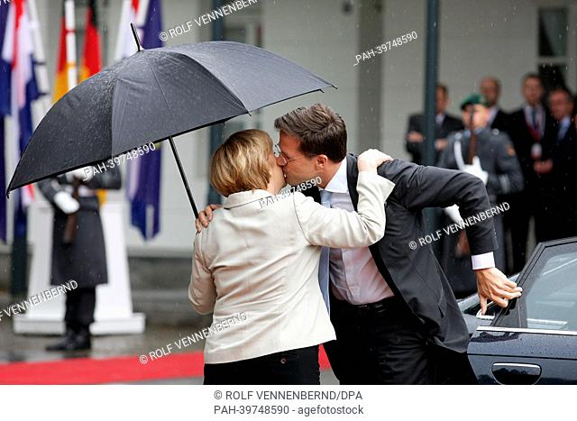German Chancellor Angela Merkel and Dutch Prime Minister MarkRutte greet each other before the first German-DutchCabinet Meeting in Kleve, Germany