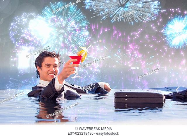 Composite image of cheerful businessman relaxing in a swimming pool with a cocktail
