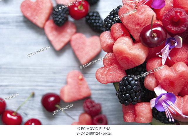 Watermelon hearts, cherries, raspberries and blackberries