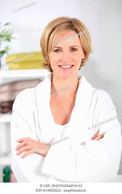 35-40 years old blonde woman dressed in bathrobe in her bathroom