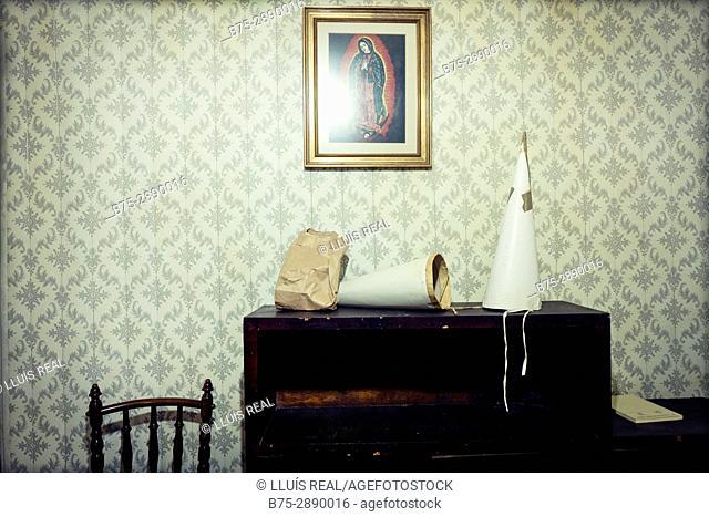 Capirote (Holy week conical headwear) on table inside Sant Josep church. Maho, Balearic Islands, Spain