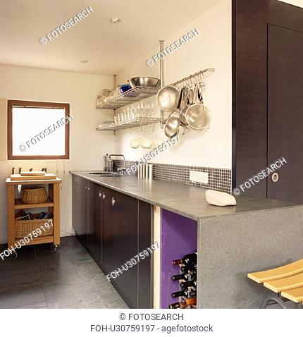 Polished concrete worktop on concrete unit in modern kitchen