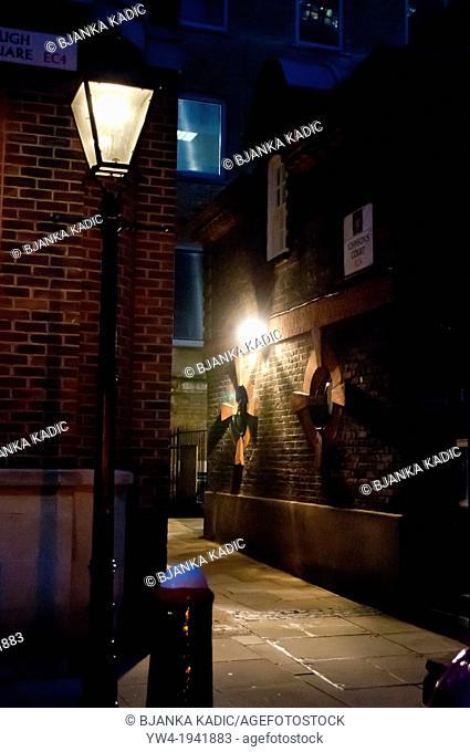 Narrow alley at night, City of London, EC4, UK