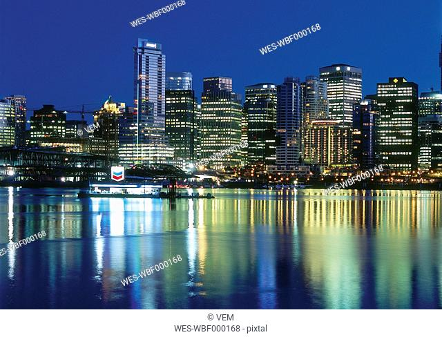 Canada, British Columbia, Vancouver, View of city skyline at night
