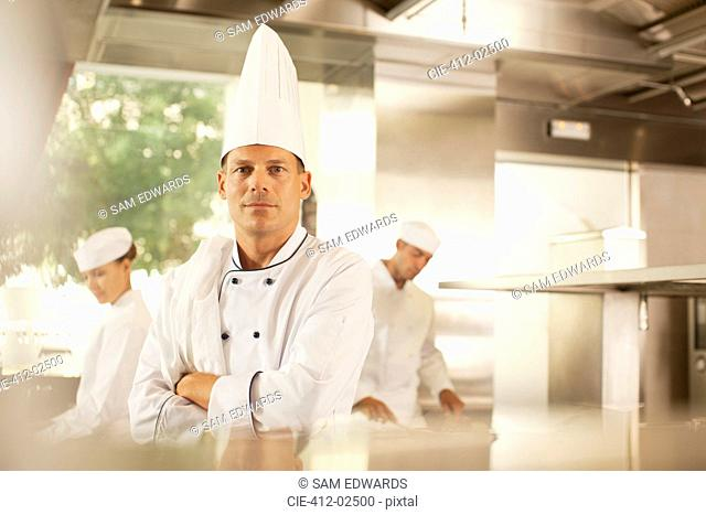 Chef standing in restaurant kitchen