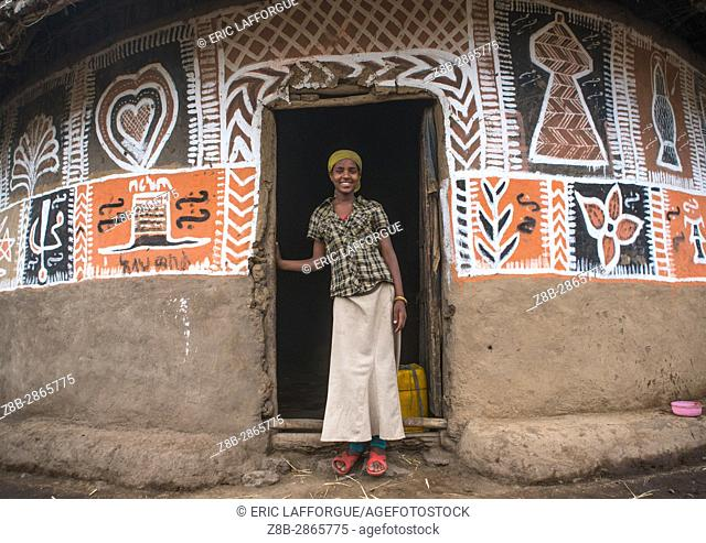 Ethiopian woman standing in front of her traditional painted house, Kembata, Alaba Kuito, Ethiopia