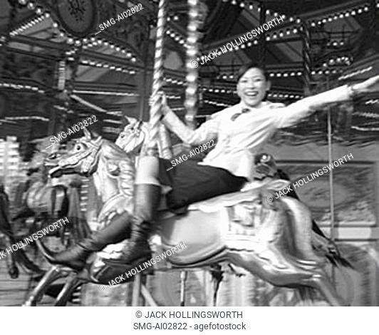 Woman on carousel