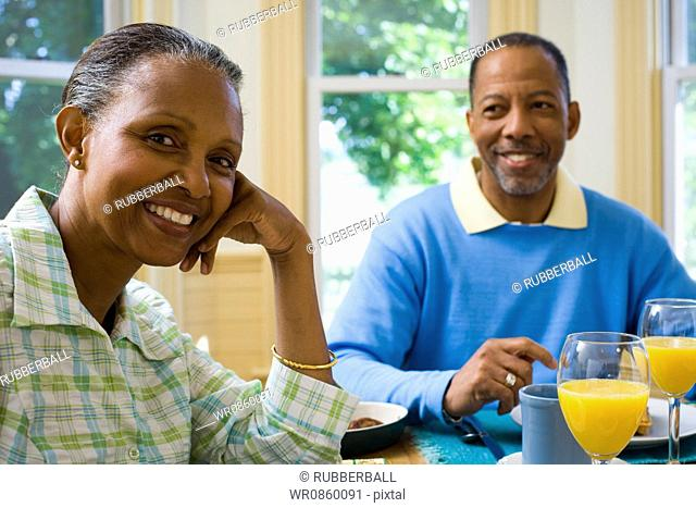 Portrait of a senior man and a senior woman sitting at the breakfast table