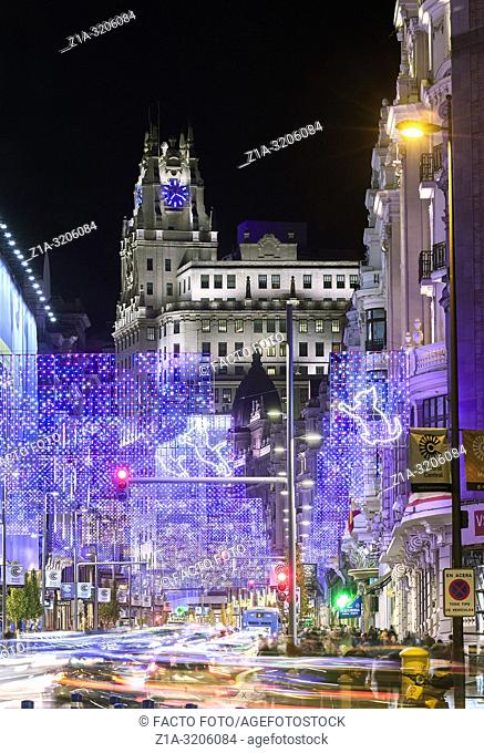 Christmas lights at Gran Via street with Telefonica building at the background. Madrid. Spain