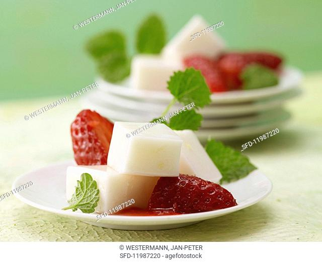 Ginger & coconut jelly with strawberries