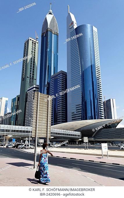Single pedestrian in front of skyscrapers, Sheikh Zayed Road, Dubai International Financial Centre, DIFC, Dubai, United Arab Emirates, Middle East, Asia