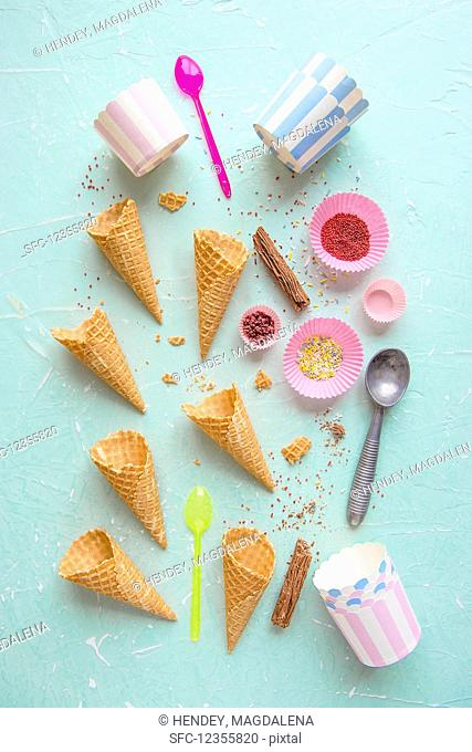 Ice cream cones, containers and sprinkles for ice cream