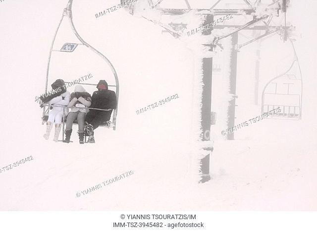 People using a ski lift in Arachova. Kellaria, Parnassos, Arachova, Viotia, Central Greece, Europe