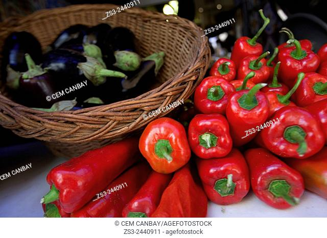 Close-Up shot of aubergines and red peppers in a basket at the shop, Rethymno, Crete, Greek Islands, Greece, Europe