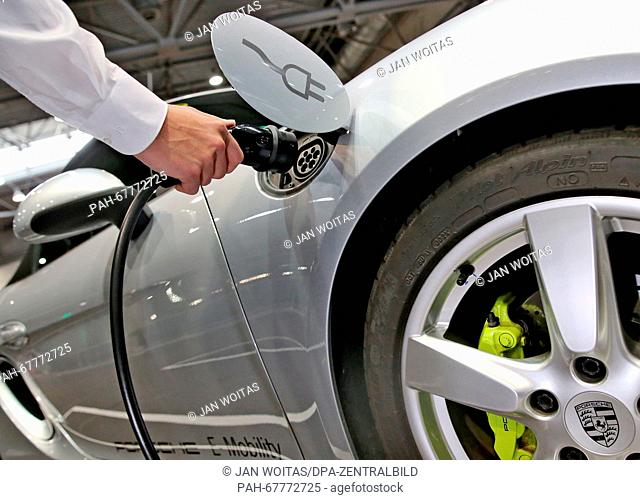 The prototype of a Porsche Boxster Eat a charging cable during a conference for electromobility in Leipzig(Saxony), Germany, 14 April 2016