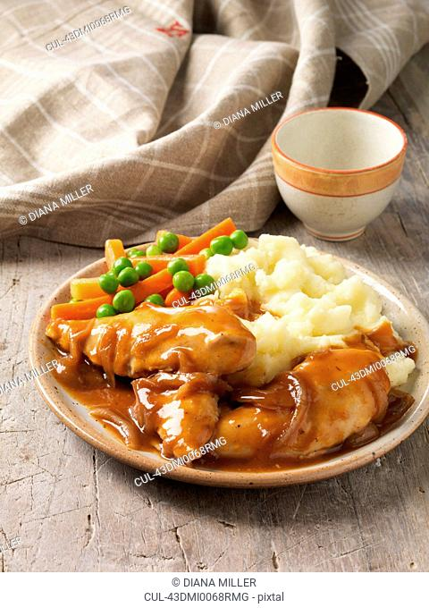 Plate of chicken, gravy and vegetables