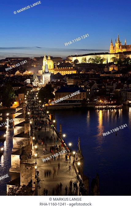 View over the River Vltava to Charles Bridge and the Castle District with St. Vitus Cathedral and Royal Palace, UNESCO World Heritage Site, Prague