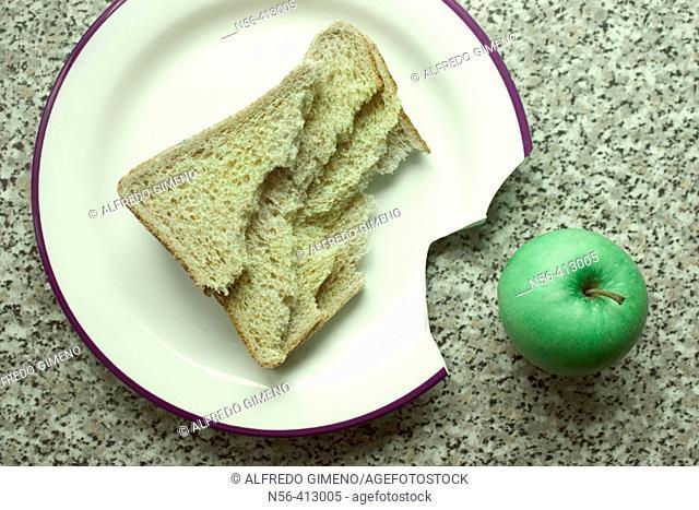 Broken dish with apple