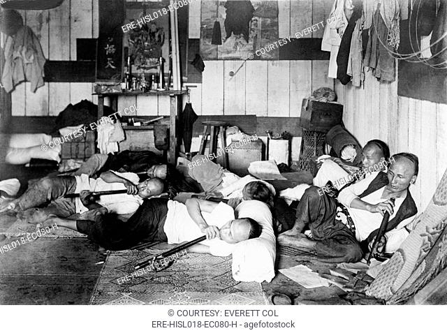 Ethnic Chinese smoking in an opium den in Manila, Philippine. 1924