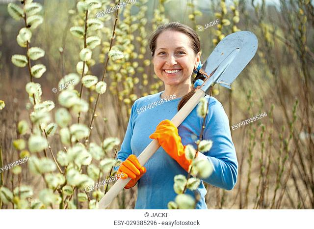 Female gardener with spade in spring plant