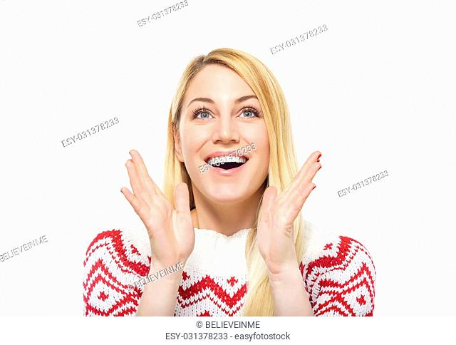 Attractive blonde in pullover surprised or glad hands up
