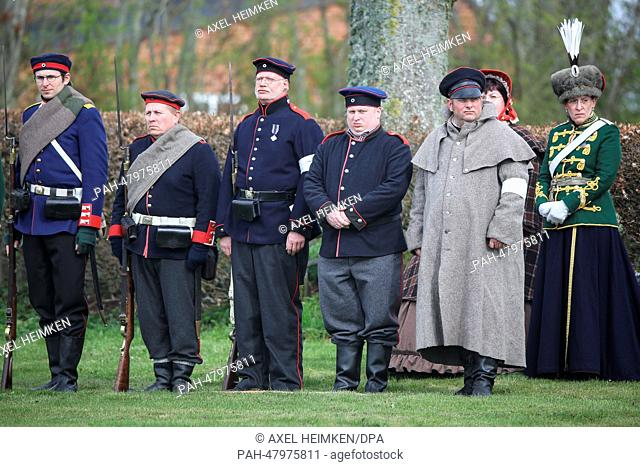 Danish civilians in historic uniforms take part in the ceremony to mark the 150th anniversary of the Battle of Dybbol in Sonderborg, Denmark,18April 2014