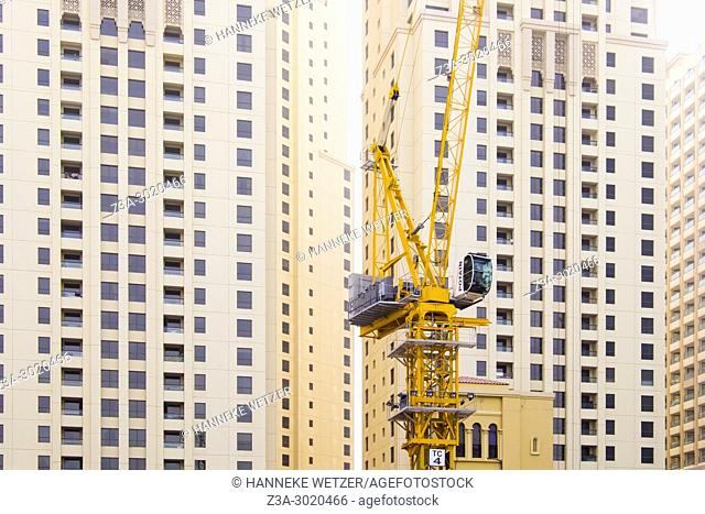 Construction site at JBR Jumeirah Beach Residence; a 1. 7 kilometres long floor area waterfront community located against the Persian Gulf in Dubai Marina in...