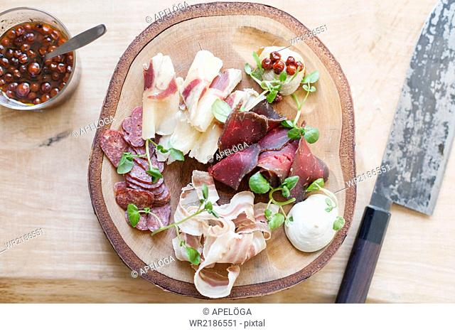 High angle view of dish on wooden plate in kitchen