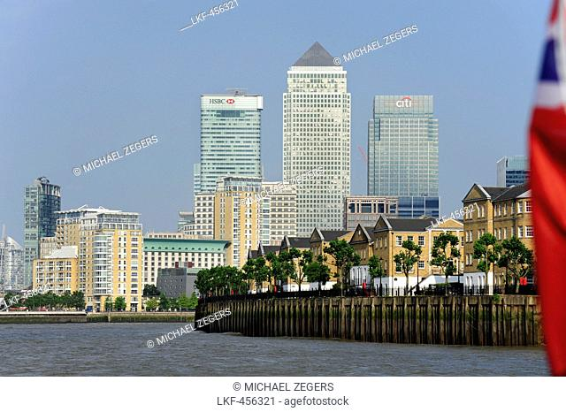 Rotherhithe quarter along the river Thames, with office towers of One Canada Square, HSBC Tower and Citigroup Centre in the background, Canary Wharf