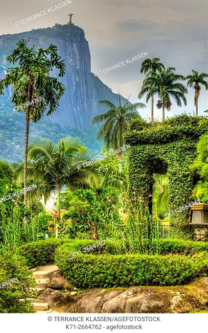 Tropical vegetation covers a pagoda at the Botanical Gardens in Rio de Janeiro, Brazil