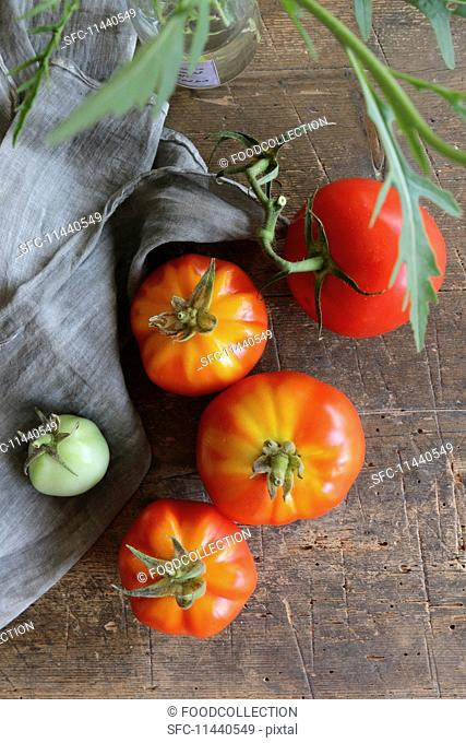 Fresh tomatoes on a rustic wooden table