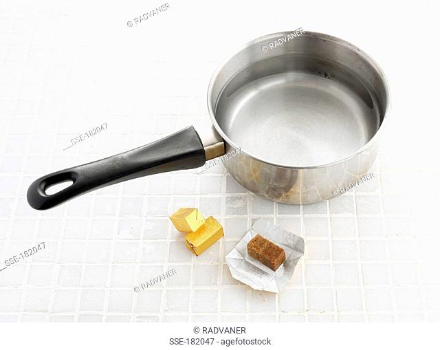 Putting a stock cube in a saucepan of water
